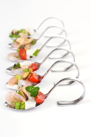 Seafood salad on spoon