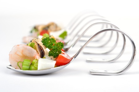 Seafood salad on spoon photo