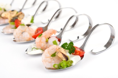 Seafood salad on spoon