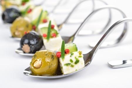 catering: Greek appetizers on spoon