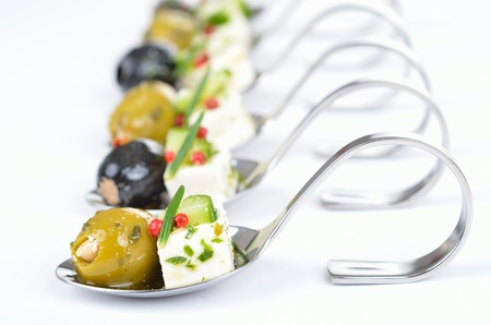 food buffet: Greek appetizers on spoon