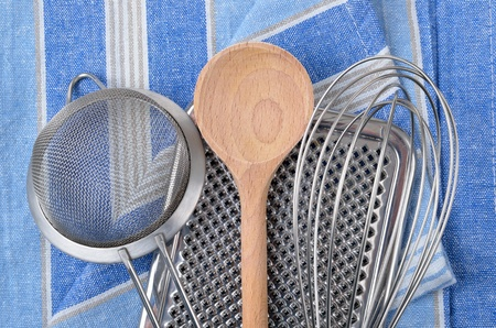 Kitchenware  on a tea towel photo