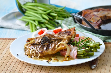 Fried lamb chops with onions and bacon-wrapped green beans photo