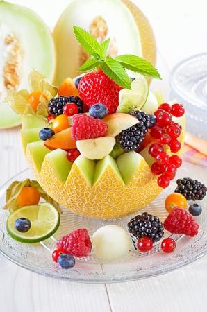 fruits basket: Fresh fruit in season filled in a melon