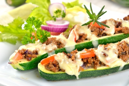 Zucchini halves stuffed with minced meat and gratinated with mozzarella photo