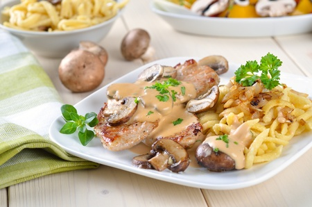 Escalope of pork with champignons and sauce Reklamní fotografie - 12657428