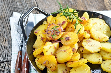 Fried potatoes in a serving pan