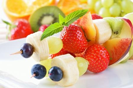 fruity salad: Ripe summer fruit in season on skewers