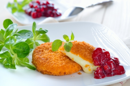 meatless: Baked camembert with cranberry sauce Stock Photo
