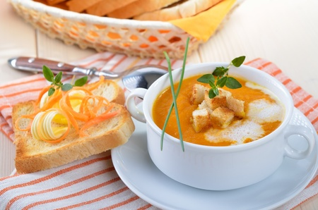 Carrot cream soup with croutons and toast Reklamní fotografie