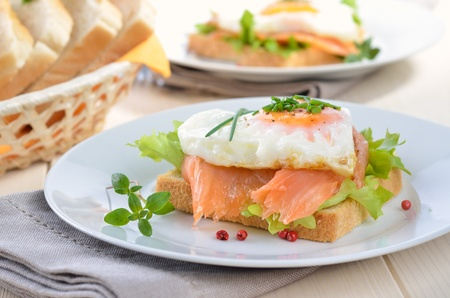 Toast with smoked salmon and heart shaped fried egg photo