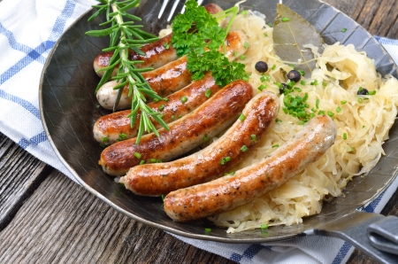 Fried sausages on sauerkraut Stock Photo