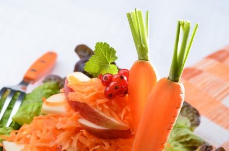 Salad of carrots, apples and lettuce Reklamní fotografie