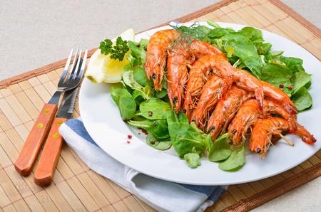 Grilled king prawns on mache