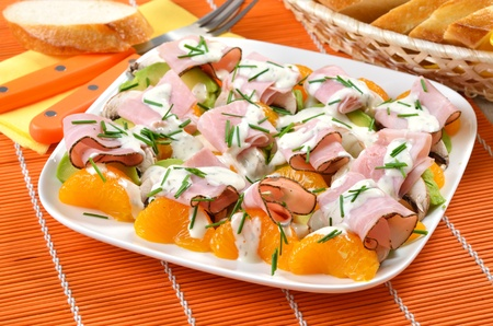 fruity salad: Colorful salad plate with avocado, champignons, mandarins and ham
