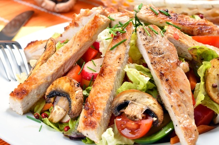 Turkey escalope on mixed salad
