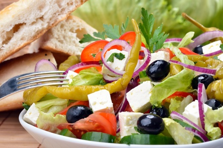 Delicious greek salad with sheep s milk cheese photo