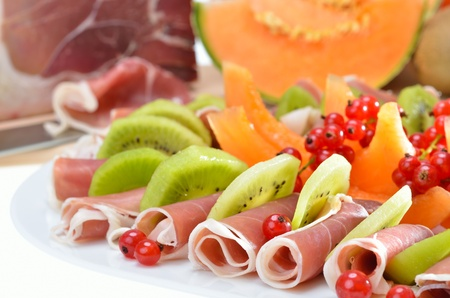 Italian ham with fresh fruits Stock Photo