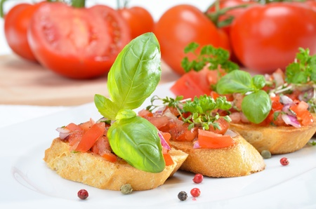food buffet: Fresh Italian bruschette with tomatoes and basil
