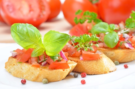 Fresh Italian bruschette with tomatoes and basil photo