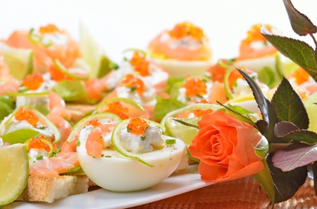 Canapes with salmon and caviar photo
