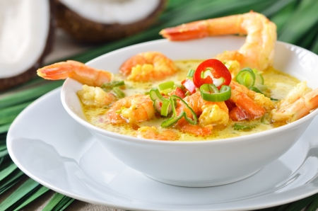 Hot shrimps soup with coconut milk photo