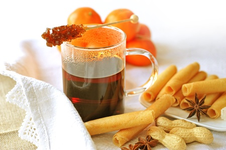 Mulled wine with rock candy and biscuits photo