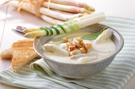 leeks: Fresh cream soup of white asparagus Stock Photo