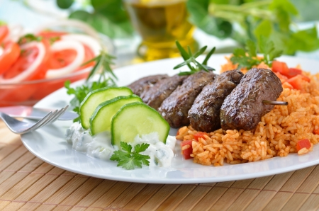 Grilled Greek meat balls with tzatziki and paprika rice