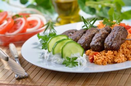 Grilled Greek meat balls with tzatziki and paprika rice Reklamní fotografie