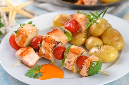 Salmon skewers with fried potatoes photo