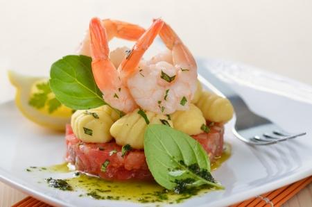 Italian gnocci and king prawns on tomato ragout with basil