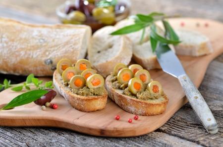 Olive paste on baked olive baguette Reklamní fotografie - 14222437