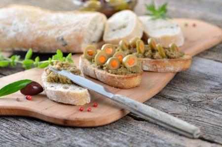 spanish tapas: Olive paste on baked olive baguette Stock Photo