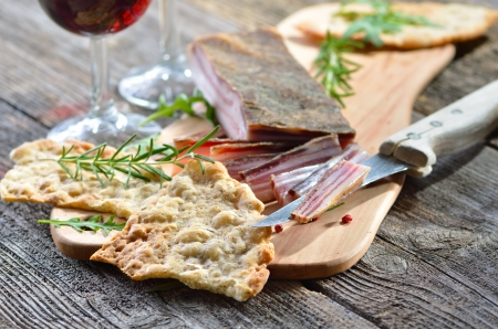 wine and dine: South Tyrolean bread specialty, so-called  Schuettelbrot , a very crispy and dry rye flatbread Stock Photo