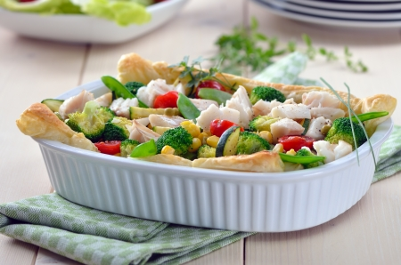 Cod fillet on mixed vegetables in season baked on puff pastry Reklamní fotografie - 14323364