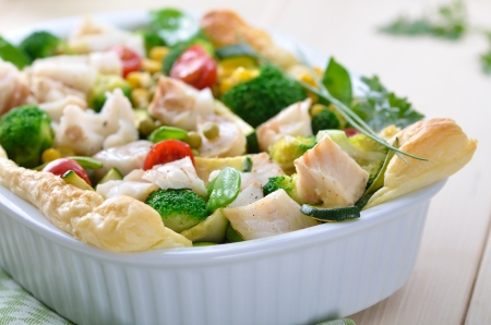cod fish: Cod fillet on mixed vegetables in season baked on puff pastry