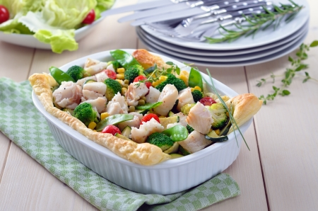 Cod fillet on mixed vegetables in season baked on puff pastry Reklamní fotografie - 14323365