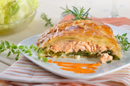 Salmon fillet on leek, baked in puff pastry Stock fotó
