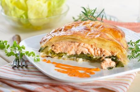 Salmon fillet on leek, baked in puff pastry Reklamní fotografie