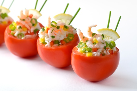 seafood platter: Stuffed tomatoes with shrimps and rice Stock Photo