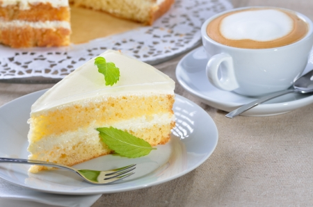 Fancy cake with a cup of cappuccino Stock Photo - 14518601