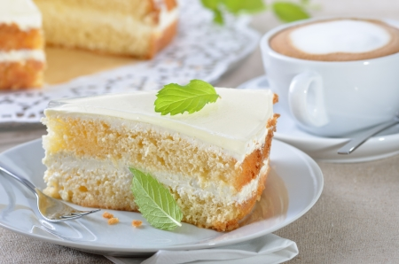 coffee hour: Fancy cake with a cup of cappuccino