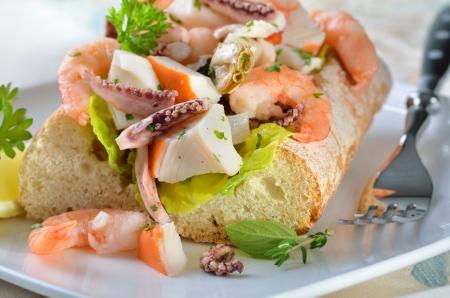Delicious seafood salad on Italian ciabatta bread photo