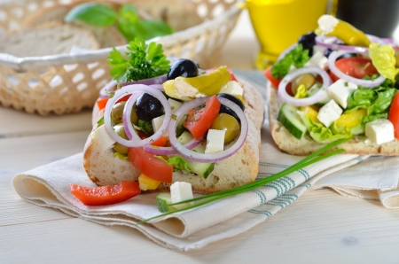 Delicious Greek country salad with feta on bread photo