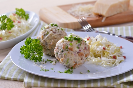 Homemade South Tyrolean bacon dumplings with cabbage salad