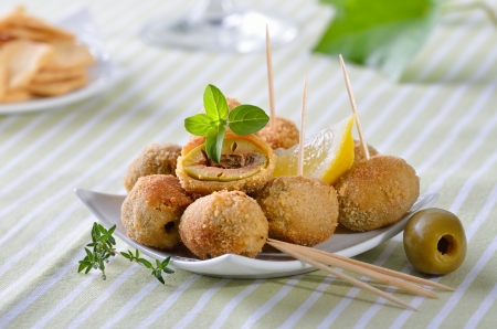 Breaded and baked green olives - a Spanish appetizer