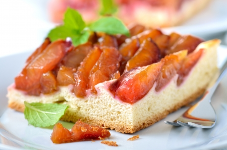 Homemade plum pie with mint leaves