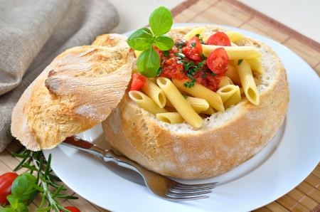 Penne rigate with tomato sauce photo