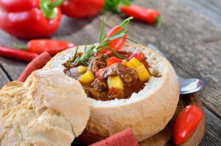 Hot Hungarian goulash soup in a loaf